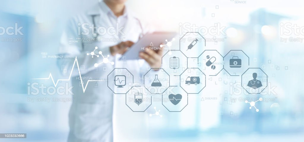Medicine doctor with stethoscope using tablet and medical icon network connection on virtual screen interface in hospital background. Modern medical technology concept. stock photo