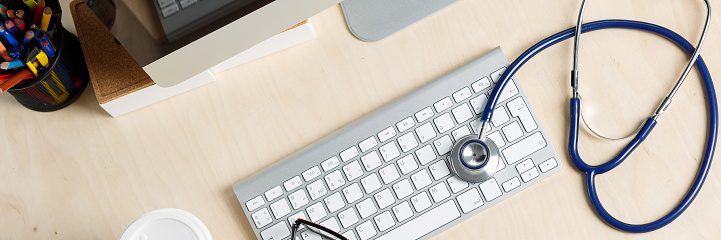 istock Medicine doctor working table view from top 852404086