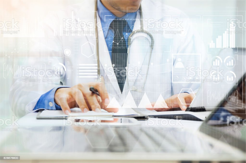 Medicine doctor working with computer notebook and digital tablet at...