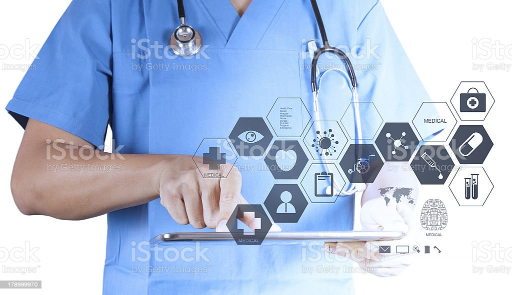 Medicine doctor working with modern tablet computer and virtual royalty-free stock photo