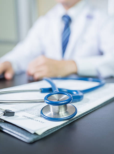 Medicine doctor's working table. Focus on stethoscope – Foto