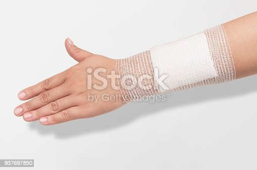 istock Medicine elastic bandage on human hand 937697850