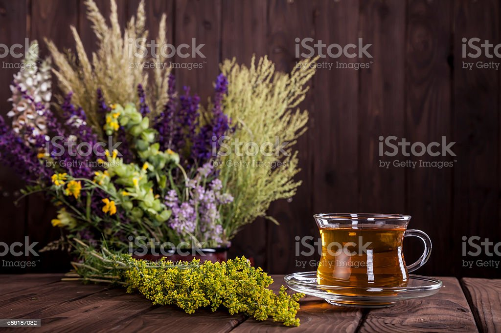 Medicine Herbs on a Wooden Table stock photo