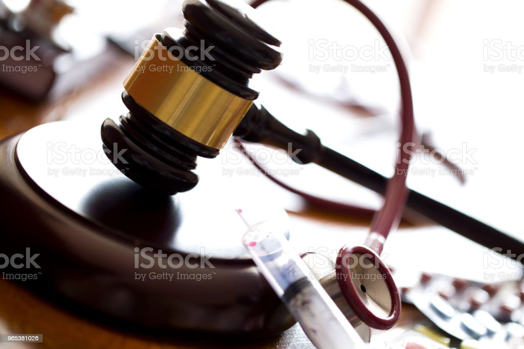 Medicine law concept. Judges gavel with  stethoscope  and pills close up royalty-free stock photo