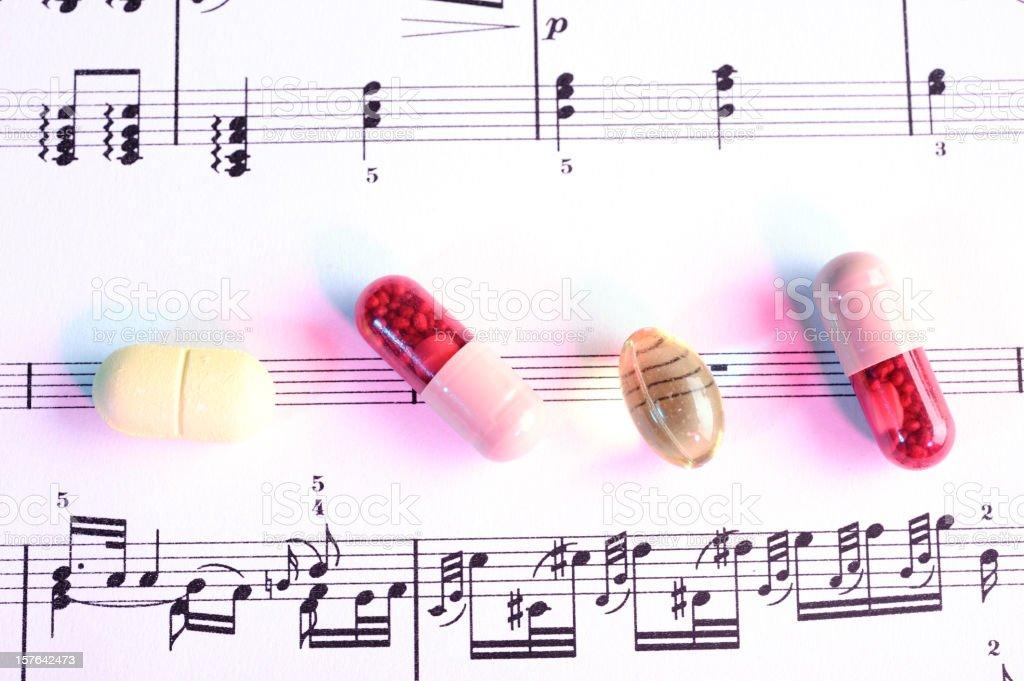 Medicine on sheet music royalty-free stock photo