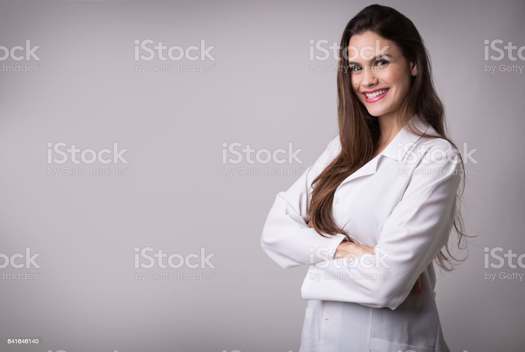 Medicine, pharmacy, health care and pharmacology concept, girl on white uniform stock photo