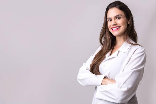 医学、薬学、健康ケア、薬理学の概念、白い制服の女の子 ストックフォト