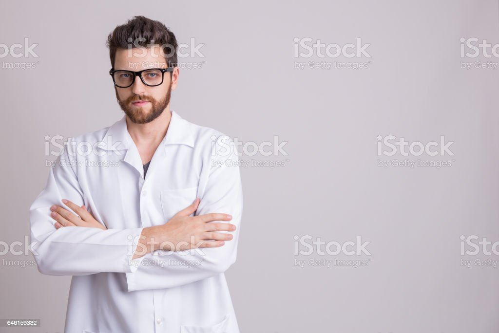 Medicine, pharmacy, health care and pharmacology concept, man on white uniform stock photo