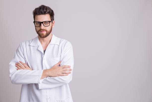 medicine, pharmacy, health care and pharmacology concept, man on white uniform - laboratory coat stock photos and pictures