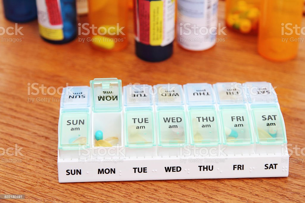 Medicine pill box daily planner stock photo