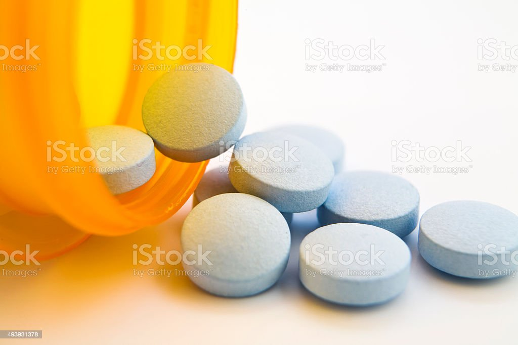 Medicine pill capsules with medicine bottle stock photo