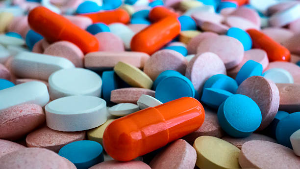 medicine pills - heaps - narcotic stock pictures, royalty-free photos & images