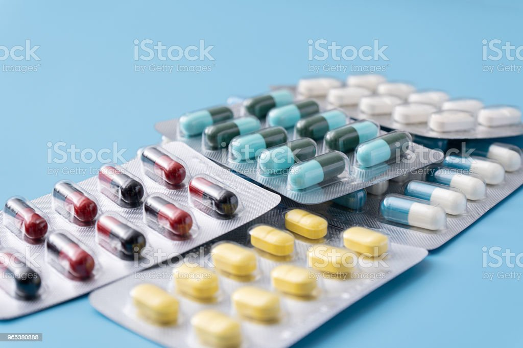 medicine  pills on blue background Copy space for text Assorted pharmaceutical Healthy Eating, Lifestyle zbiór zdjęć royalty-free