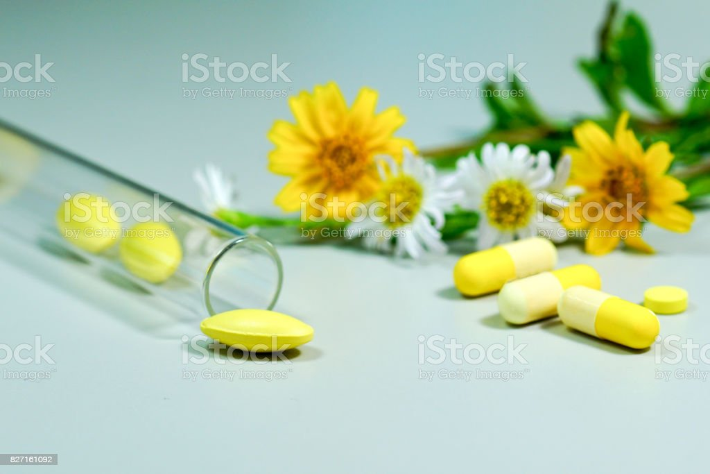 Medicine pills with yellow and white flower stock photo more medicine pills with yellow and white flower royalty free stock photo mightylinksfo