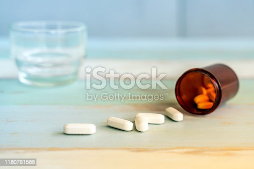 1087546614 istock photo medicine spilling out 1180761588
