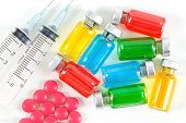 """Macro Shot Of Colorful Vials, Pills, and Syringes."""