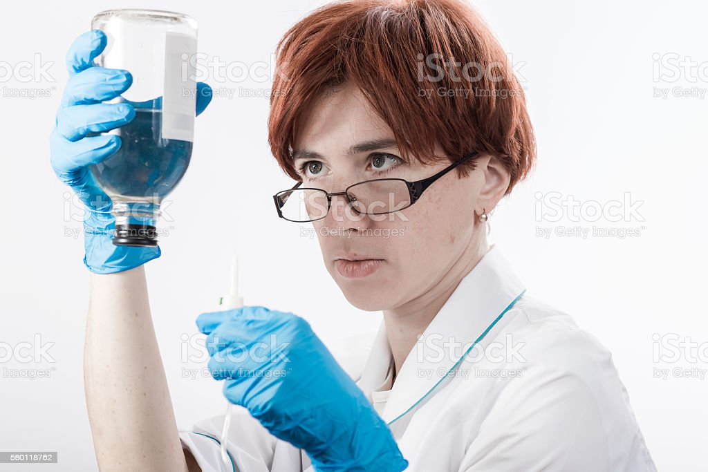 Medicine woman with dropper stock photo