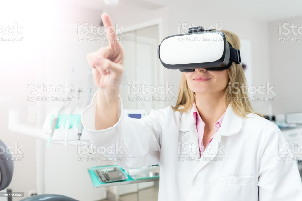 Medicine worker touchscreen & using Vr headset stock photo