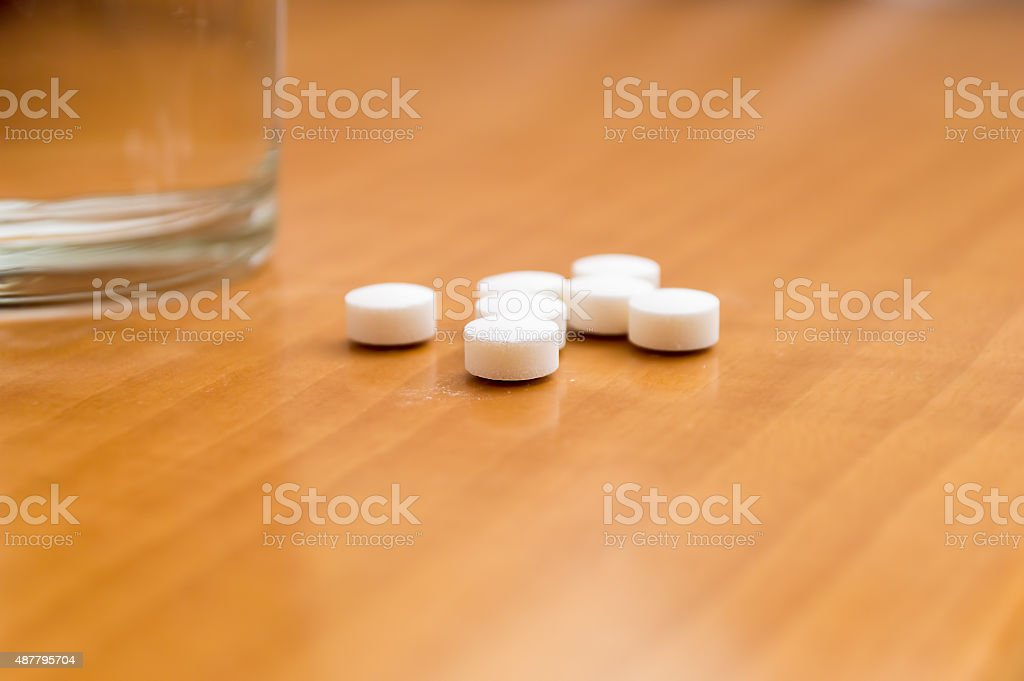 medicines on nightstand stock photo