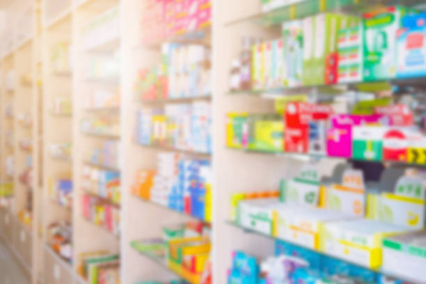 medicines on pharmacy shelves blurred background - covering stock photos and pictures