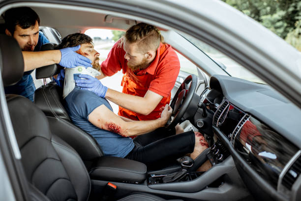 medics providing emergency medical assistance after the road accident - victim stock pictures, royalty-free photos & images
