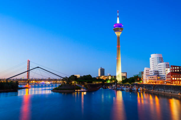 Medienhafen Media Harbour district, Dusseldorf Rheinturm and Media Harbour district in Dusseldorf city in Germany north rhine westphalia stock pictures, royalty-free photos & images
