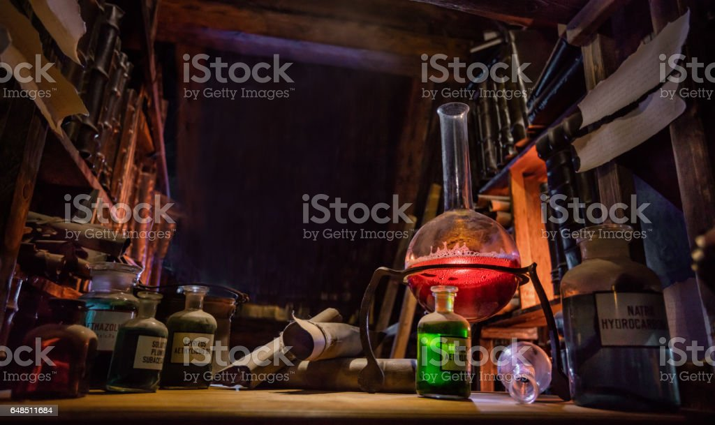 Medieval alchemist laboratory stock photo