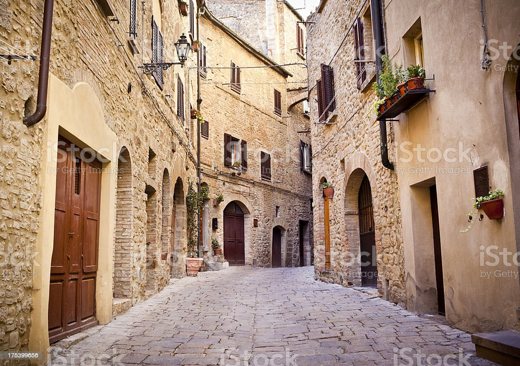 Medieval Alley In Volterra, Tuscany Italy stock photo