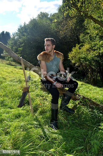 630040004istockphoto Medieval archer   on branch with drinking horn ,bow and arrow 635977516