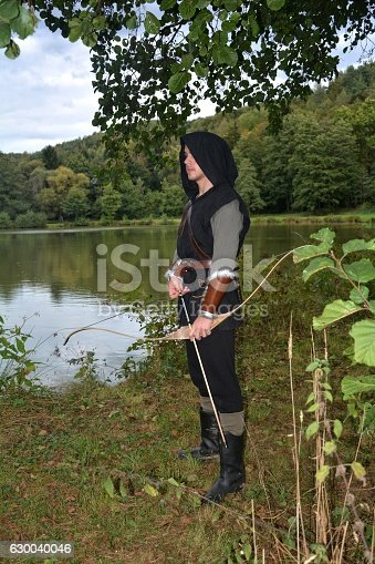 630040004istockphoto Medieval archer  stands with tense curve and with arrows 630040046