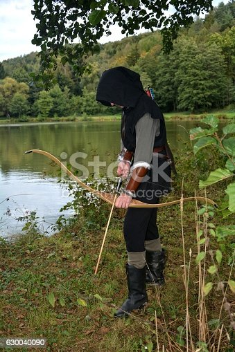 630040004istockphoto Medieval archer  stands with tense curve and with arrows 630040090