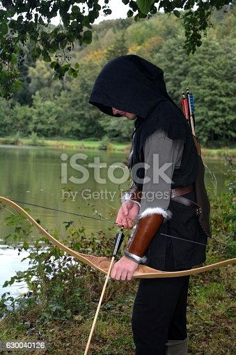 630040004istockphoto Medieval archer  stands with tense curve and with arrows 630040126