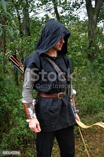 630040004istockphoto Medieval archer  with coloured arrows stands with bow 630040254