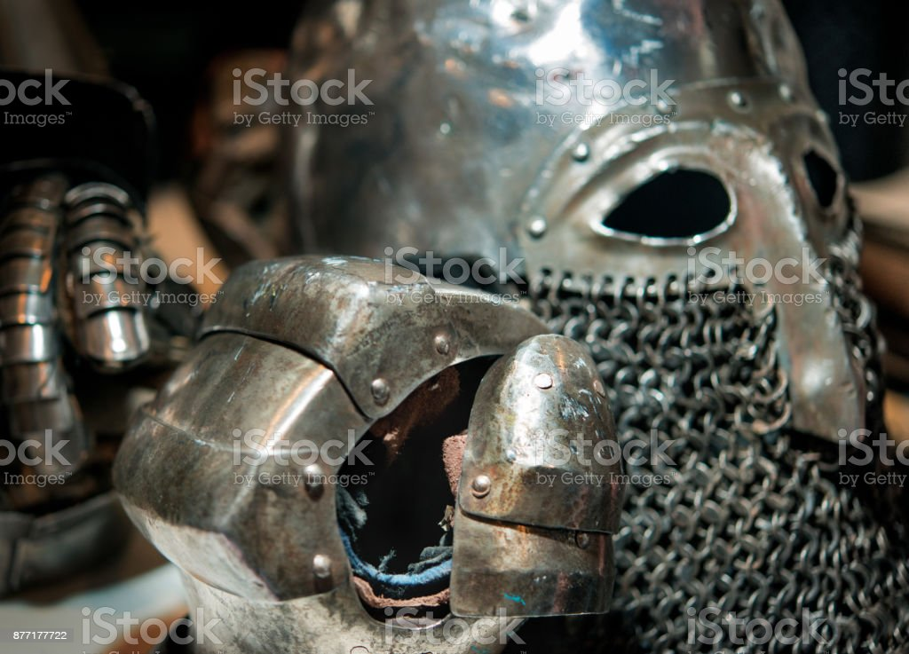 medieval armor of metal helmet and glove stock photo