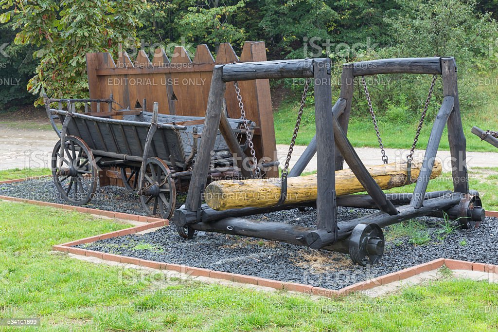 Medieval battering ram on wheels and cart for projectiles stock photo