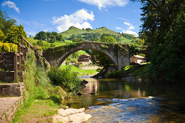 Medieval bridge and Miera River in Spain in the province of Santander, Cantabria, Spain cantabria stock pictures, royalty-free photos & images