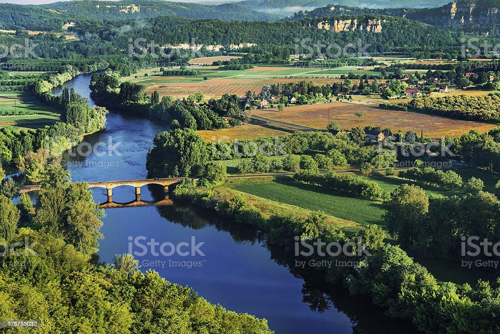 medieval bridge over the dordogne river stock photo