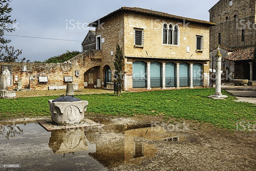 Medieval building and  architecural fragments, Torcello, Italy stock photo