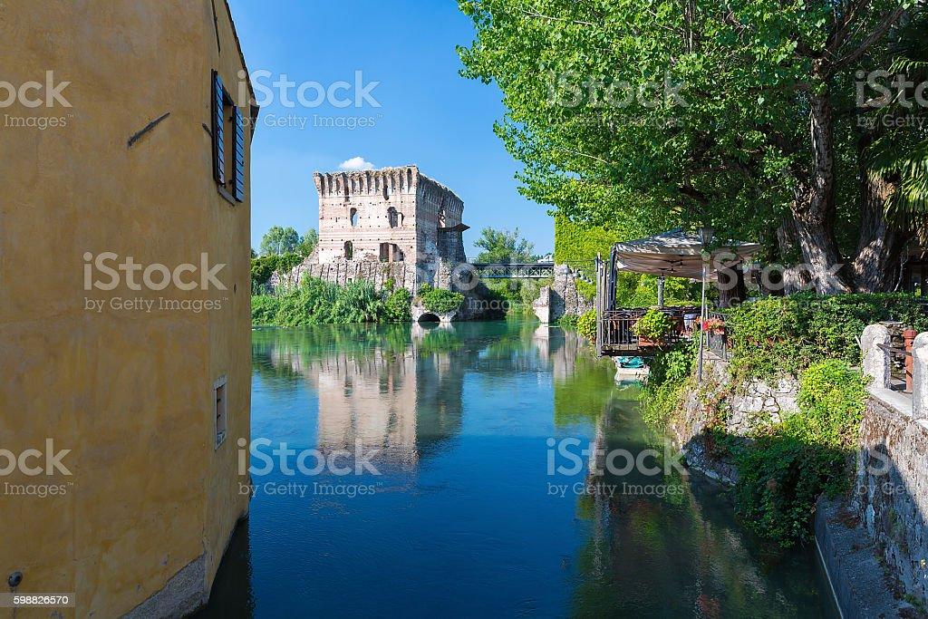 medieval building upon the Mincio river in Borghetto stock photo