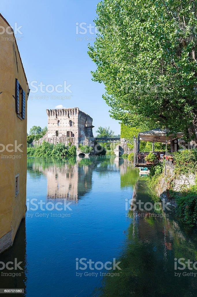 medieval building upon the Mincio river stock photo