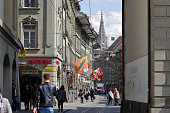 Bern, Switzerland - April 17, 2019: Along one of the streets there are tram tracks used for public transport. Medieval buildings are on both sides of the street. The City of Bern is one of the countless great places in Switzerland and it is the political centre of this Country. Numerous museums, a wide cultural offer, a variety of tourist attractions makes it a travel destination for tourists from all over the world.