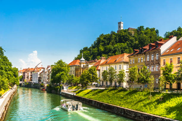 medieval buildings and ljubljanica river in Ljubljana - Slovenia View on medieval buildings and ljubljanica river in Ljubljana - Slovenia ljubljana stock pictures, royalty-free photos & images