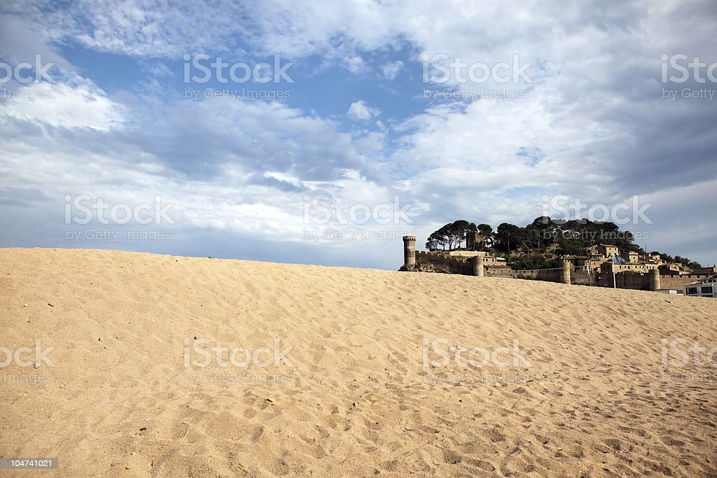 Medieval castle sorrounded by sand royalty-free stock photo