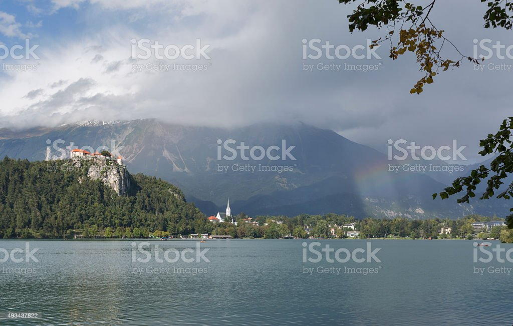 Medieval castle, St. Martins Parish Church and Bled Lake stock photo
