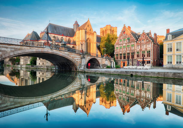 Medieval cathedral and bridge over a canal in Ghent - Gent, Belgium, Sint - Michielskerk Medieval cathedral and bridge over a canal in Ghent - Gent, Belgium, Sint - Michielskerk belgium stock pictures, royalty-free photos & images