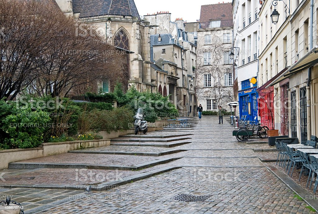 Medieval cathedral on pedestrian street in Le Marais stock photo