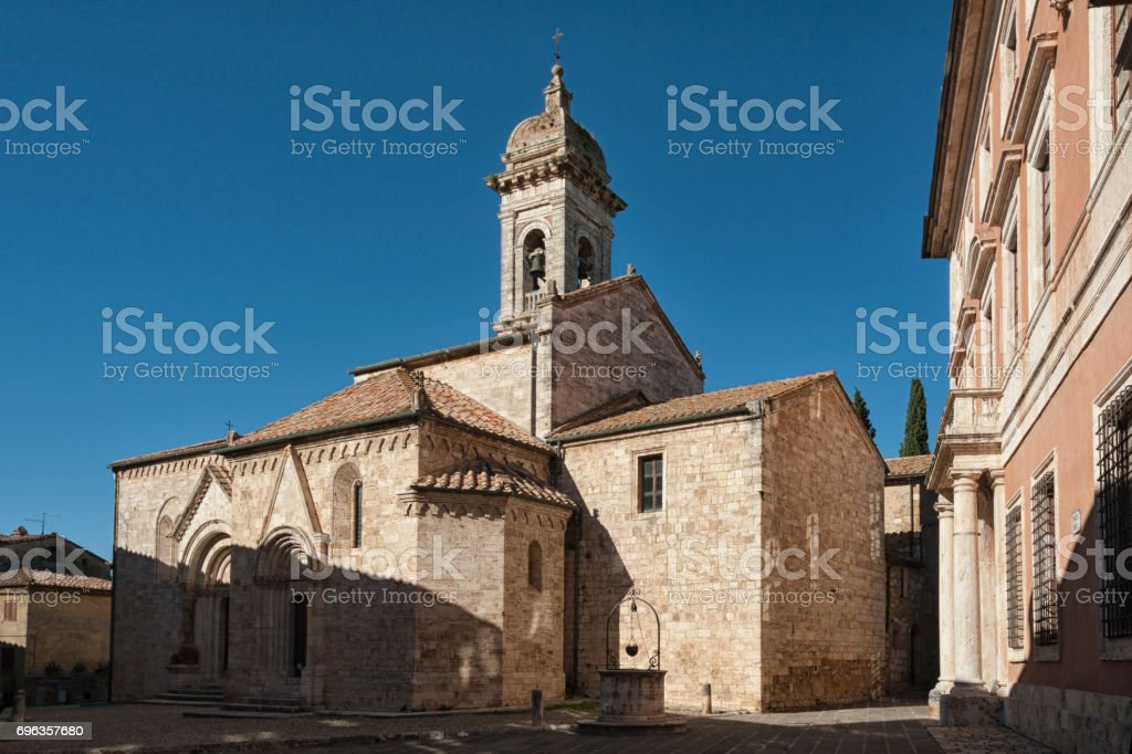 SAN QUIRICO D'ORCIA, ITALY - OCTOBER 30, 2016 - Medieval catholic church in Tuscany, la Collegiata (sec. XIV) antique cathedral of San Quirico d'Orcia, Siena, Italy stock photo