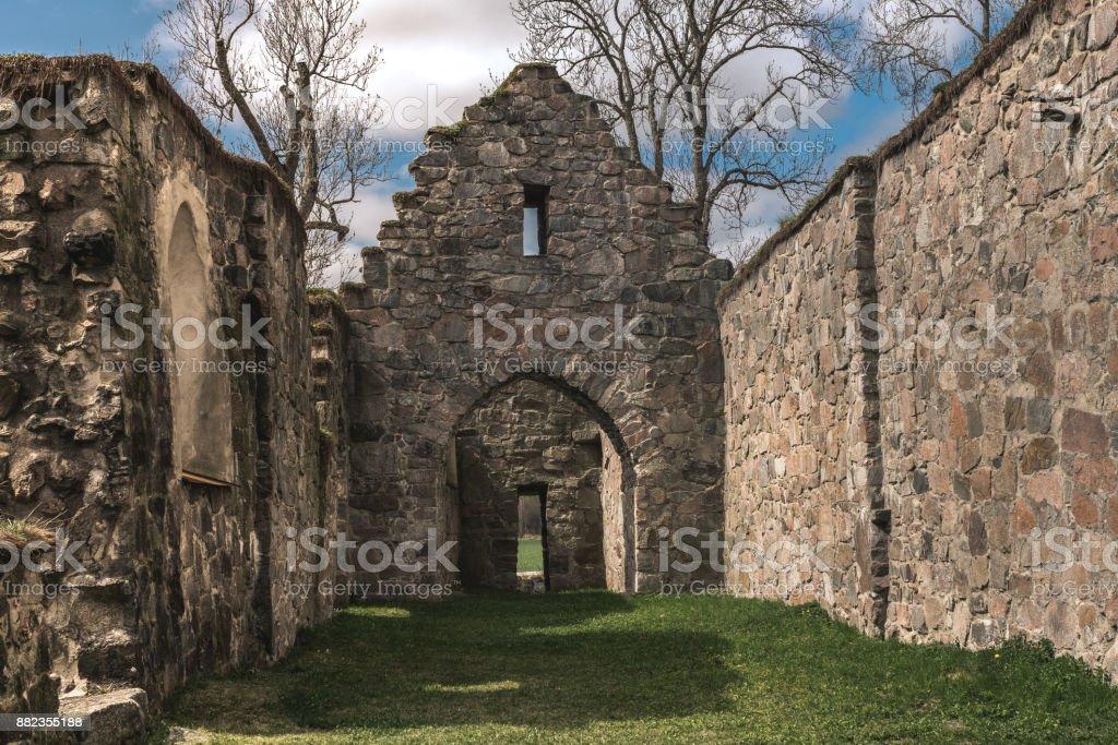 Medieval church ruin in spring sunlight stock photo