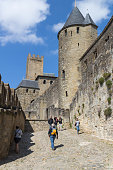 Carcassonne, France - April 24, 2017: Medieval citadel of Carcassonne. Carcassonne is in the Aude department and chief town of the Languedoc-Roussillon region in the south-west France. Its historic center consists of a walled medieval citadel protected by UNESCO since 1997.