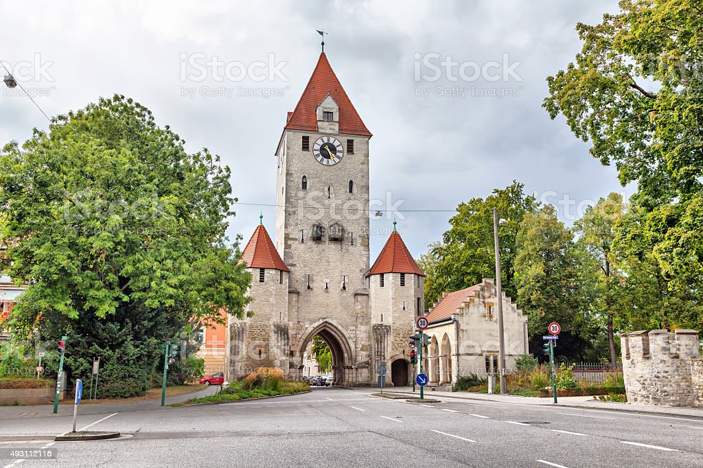 Medieval city gate with clock tower in Regensburg stock photo